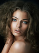 Sexy beautiful young woman face with clean skin. Natural mekeup