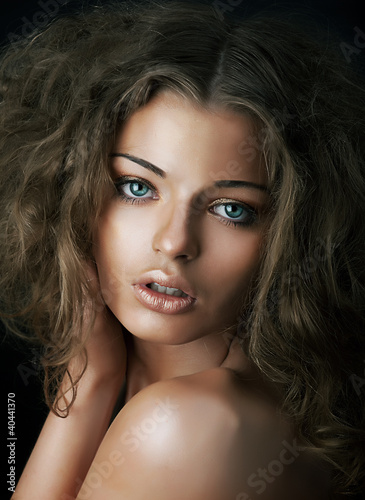 Sexy beautiful young woman face with clean skin. Natural mekeup