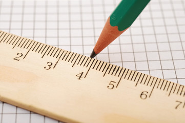 closeup wooden ruler and pencil on background