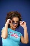 woman with curly hair wearing sunglasses