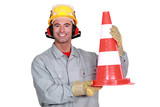 Happy worker with traffic cone