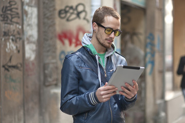 Man On Street Use Ipad Tablet Computer