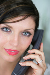 Close-up of brunette on the phone