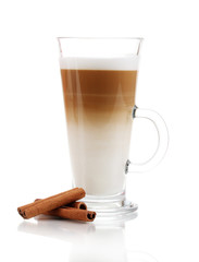 Fragrant сoffee latte in glass cup and cinnamon isolated