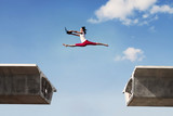 Fototapety Attractive woman jumping with laptop