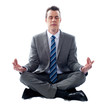 Businessman meditating in lotus position