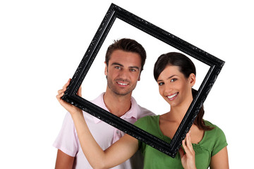 Man and woman withframe