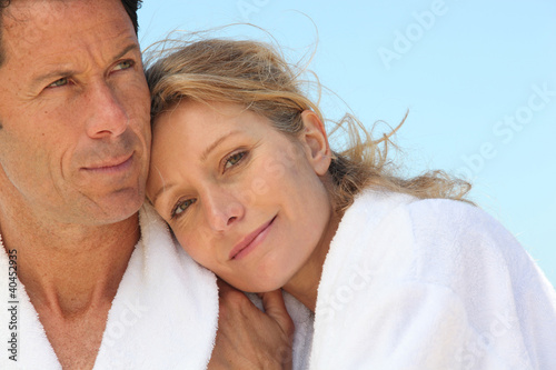 Couple in bathrobes showing affection