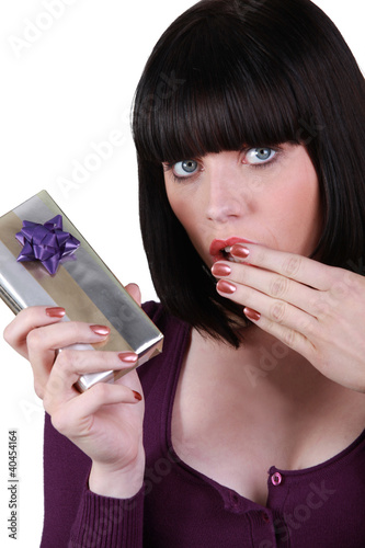 brunette stunned at gift