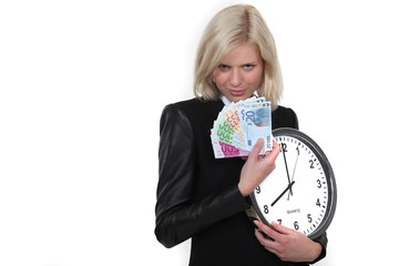 Businesswoman with a clock and cash