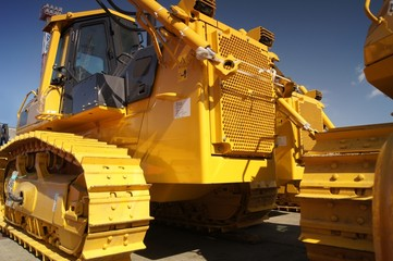 Yellow bulldozer ready for transportation by rail
