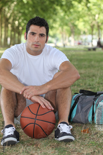 Basketball player sitting