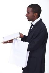 black waiter giving the bill