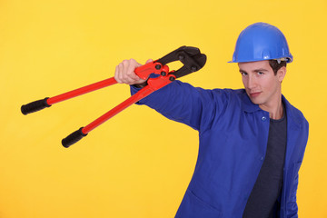 young blue collar posing against yellow background
