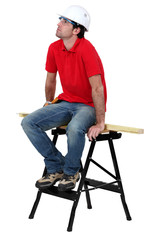 Carpenter sat on work-bench