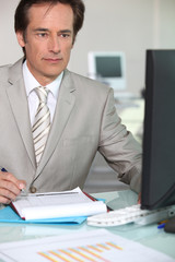 Mature businessman working at his desk