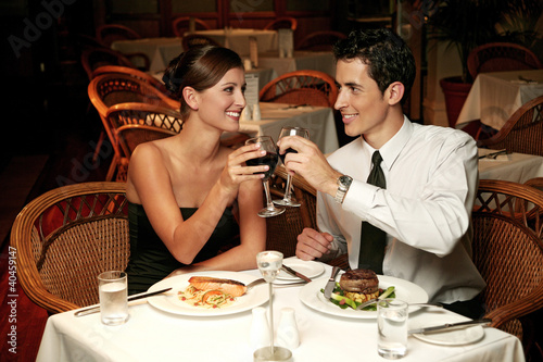 A couple having a toast in the restaurant.