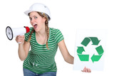 Female builder encouraging people to recycle