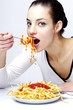 Woman eating pasta.