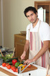 Man cutting vegetables on a chopping board