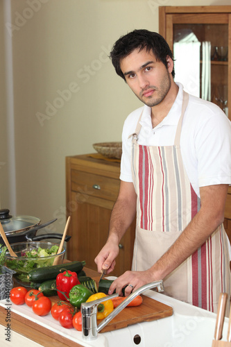 Man cutting vegetables on a chopping board