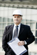 Senior businessman wearing a safety helmet.