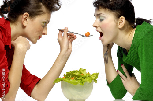 Woman feeding her friend.