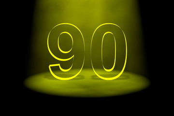 Number 90 illuminated with yellow light