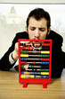 Businessman playing with children abacus.