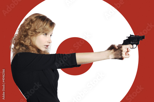 Businesswoman aiming a pistol.