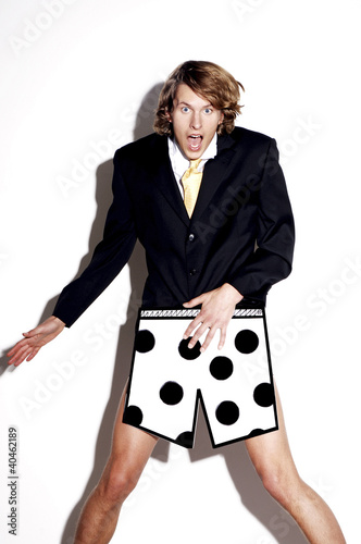 Businessman in boxer shorts showing shocked expression.