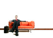 Businessman sitting on the couch with his legs crossed.