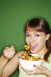 Woman enjoying a bowl of salad.