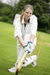 Female cricket player holding a cricket bat