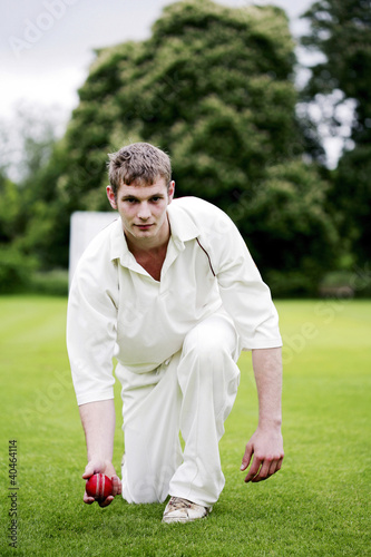 Man preparing to throw a cricket ball