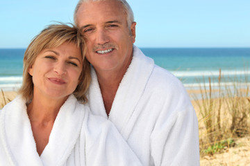 Mature couple in bathrobe