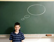 Boy standing in front of a blackboard with thought bubble