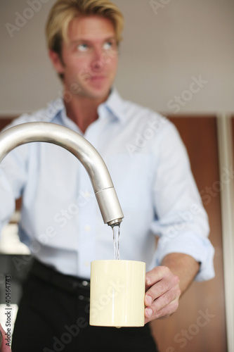 Man washing cup