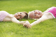 Girls lying on the grass