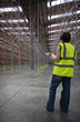 Man checking condition of warehouse