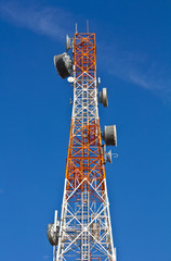 Telecommunications tower under a blue sky.