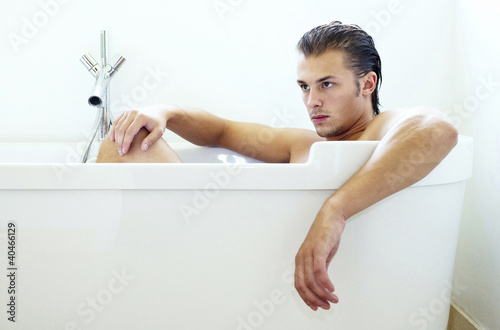 Man sitting in the bathtub