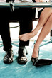 Business people playing footsie