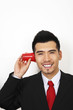 Businessman playing with plastic cup phone