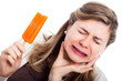 Woman with hypersensitive teeth eating ice lolly - 40473573