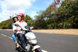 Couple riding motorbike on a country road
