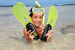 Closeup of smiling woman with diving mask and flippers