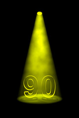 Number 90 illuminated with yellow spotlight