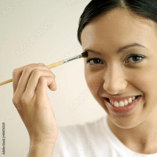 Woman applying eye shadow
