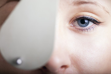 Beautiful young woman having eye test